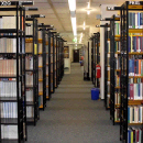 Photo: seemingly endless corridor with book shelves on the right and the left