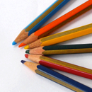 Photo: coloured pencils lying in a semi circle